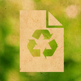 Recycle paper logo. Green recycle paper logo on paper texture Stock Images