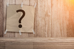 Recycle paper pad with question mark symbol on wooden background Royalty Free Stock Images
