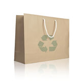 Recycle paper shopping bag on reflect white floor Royalty Free Stock Images
