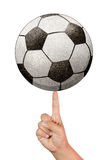 Recycle paper Soccer ball on an index finger Stock Photography