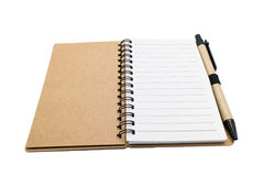 Recycle paper spiral notebook with pen isolated on white backgro Stock Photo