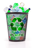 Recycle (plastic). Recycle bin filled with plastic bottles royalty free stock photography