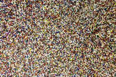 Blur of Colorful Bits Texture. Recycle plastic chip texture of colors. Don`t look to long into it royalty free stock photos