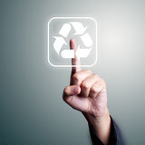 Recycle push. Business man hand pushing recycle button Royalty Free Stock Photography