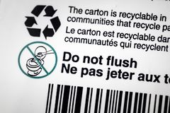 Recycle recyclable carton container label flush. Recycle recyclable carton container label do not flush wipes towel towels toilet stock photography