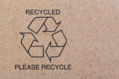 Recycle on recycled cardboard Stock Image