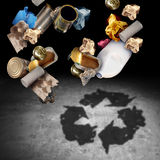 Recycle And Recycling Concept. As a symbol of throwing garbage and reusable waste management as old paper glass metal and plastic household products casting a Stock Images