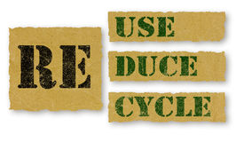 Recycle -Reuse-Reuse words on paper Royalty Free Stock Photos