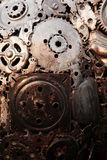 Recycle rough metal cogwheel texture background Stock Photos