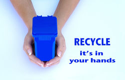 Recycle, it's in your hands. Hands holding a recycling container Royalty Free Stock Photos
