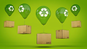 Recycle se connectent un ballon et un carton brillants verts Photos stock