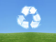 Recycle sign. In the sky created from clouds Stock Photos