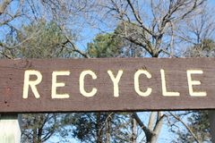 Recycle Sign. View of a sign at recycling station Stock Photos