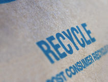 Recycle sign. Blue recycle sign on a recycled paper Stock Photo
