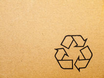 Recycle sign. On brown cardboard box Royalty Free Stock Photos