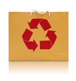 Recycle sign on brown paper bag. Isolated Royalty Free Stock Images