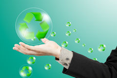 Recycle sign on business hand Stock Image