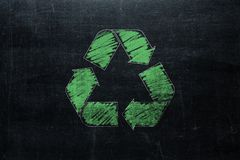 Recycle sign on chalkboard isolated on blackboard texture with c royalty free stock photo