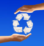 Recycle sign from clouds. In the hands Royalty Free Stock Image