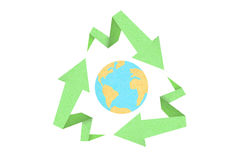 Recycle sign created with arrow origami paper. Texture style with the world inside Stock Images