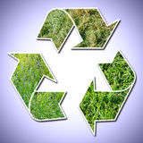 Recycle sign grass vignetted Stock Images