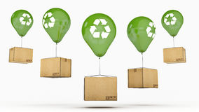Recycle sign On a Green Glossy Balloon and cardboard Stock Photo