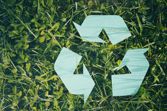 Recycle Sign on Green Grass Royalty Free Stock Image