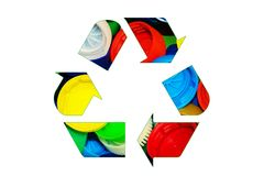 Recycle sign logo made of colorful bright bottle caps isolated o Stock Images