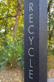 Recycle Sign. Recycling signpost in the woods Royalty Free Stock Photography