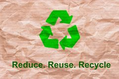 Recycle sign on wrapping paper. Reuse reduce recycle concept royalty free illustration