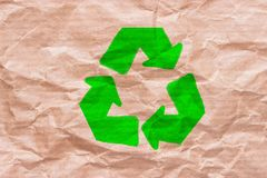 Recycle sign on wrapping paper. Reuse reduce recycle concept stock illustration
