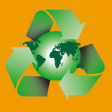 Recycle symbol. Am image showing the world with a globe shape behind encircled by three recycle green arrows symbol Royalty Free Stock Images