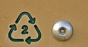 Recycle Symbol 2. Recycle Symbol #2 embeded on Outdoor Playground Equipment with Special Bolt Stock Photography