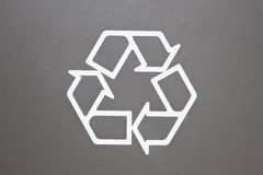Recycle Symbol. On grey background, environmental close-up Stock Photo