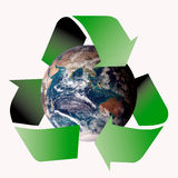Recycle symbol. Am image showing the world encircled by three recycle green arrows symbol (planet image part of NASA free image policy royalty free illustration