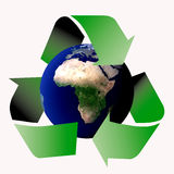 Recycle symbol. Am image showing the world  encircled by three recycle green arrows symbol (planet image part of NASA free image policy Stock Photography