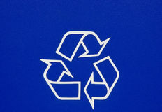Recycle Symbol. White recycle symbol on dark blue Royalty Free Stock Photos