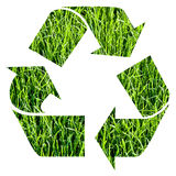Recycle symbol. Obtained cutting out photographic green grass royalty free illustration