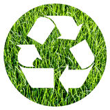 Recycle symbol. Inside a circle of photographic green grass Stock Photos