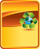 Recycle symbol around earth on orange backdrop Stock Photos