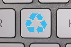 Recycle Symbol on a Blue Keyboard Royalty Free Stock Photo