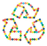 Recycle Symbol with bottle caps. Recycle Symbol made with colorful plastic bottle caps on white background Royalty Free Stock Photos