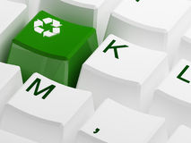 Recycle symbol button on white keyboard Royalty Free Stock Images