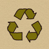 Recycle symbol on cardboard. Royalty Free Stock Photo