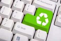 Recycle symbol on the computer keyboard. In green Royalty Free Stock Images