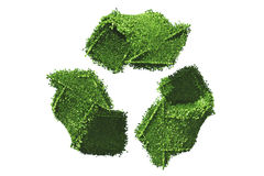 Recycle symbol covered by grass. A recycle symbol that is made in 3D render is covered by grass and isolated on white background Stock Photo