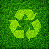 Recycle symbol on a fresh green grass, environmental concept Stock Photography