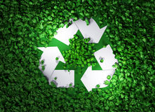 Recycle symbol among the grass. A top view of a white recycle symbol that is lying among a field of green grass is illuminated by two lights, and they are very vector illustration
