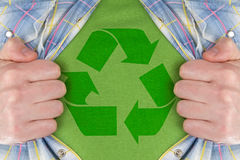 The recycle symbol on a green T-Shirt. Man showing the recycle symbol on a green T-Shirt Stock Photo