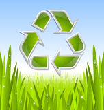 Recycle symbol icon. Green and glossy recycled symbol icon with grass and morning dew Royalty Free Stock Photos